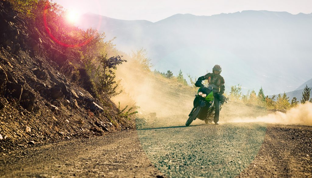 Dual sport motorcycle making a turn on the highline road near pemberton