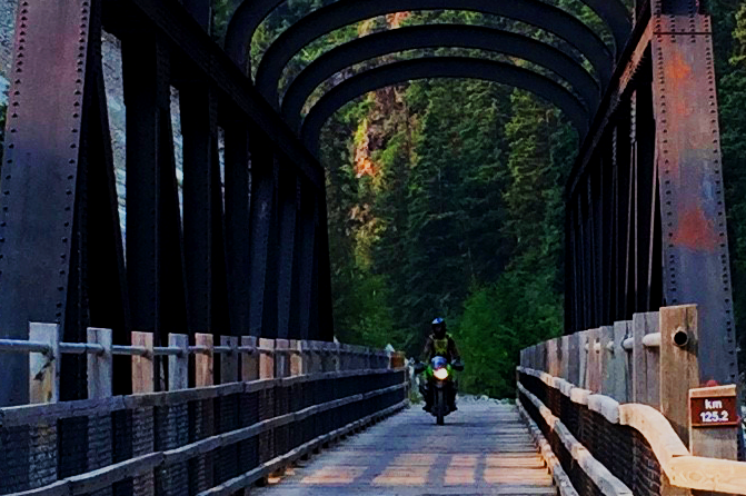 motorcycle riding bridge on Kettle Valley Railway