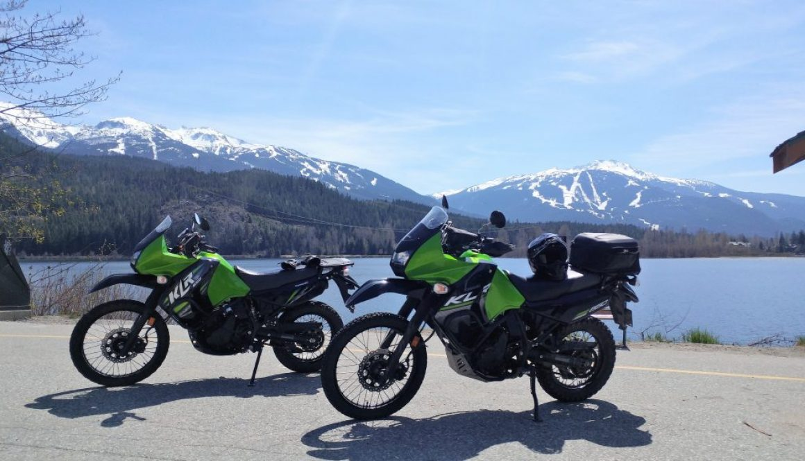 2 KLR 650 motorcycles in front of Emerald Lake Whistler