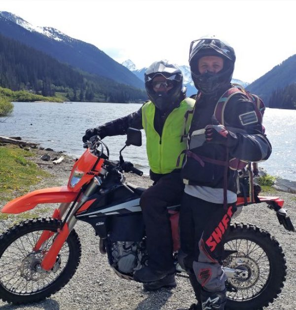 Motorcyclists in front of the Duffey Lake near Pemberton