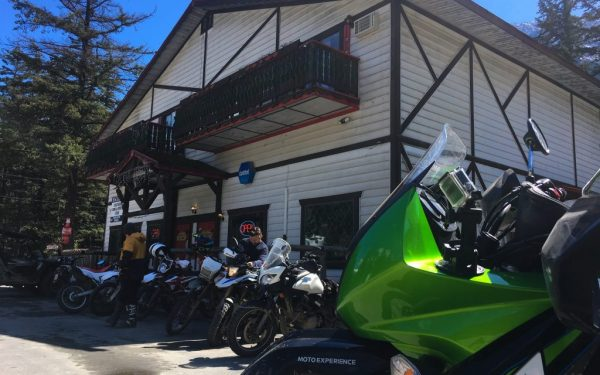 Photos of Motorcycles lined up outside of the Barrel on Inn, located at Seton Portage (Moto Experience Adventure Info)