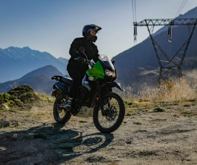 An off-road motorcycle turning in front of a camera Andserson Lake British Columbia