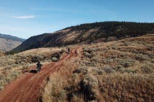 Drone photo of motorcycle tour riding through Lillooet